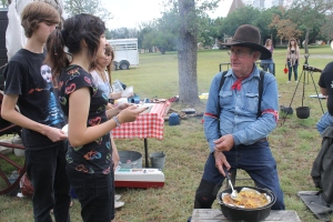 The chuck wagon cowboys cooked the students an old Dutch oven style peach cobbler.